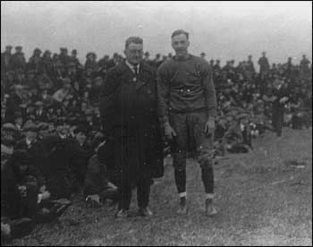 "George Gipp joins all-time great ND fullback Louis ""Red"" Salmon on the sidelines before Notre Dame's first homecoming game against Purdue in 1920. (Photo courtesy of the University of Notre Dame Archives)"
