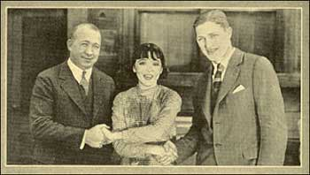Rockne and captain Adam Walsh, with film star Coleen Moore.