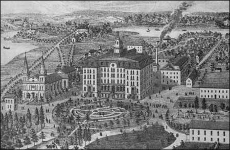 The campus in 1866 with the second Main Building, ca. 1866. Notice the heart-shaped design of the formal garden, to remind visitors of the Divine Heart of Jesus, an emblem of the Holy Cross community.