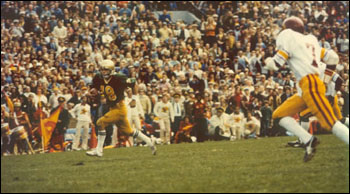 Ted Burgmeier (18) runs 21 yards on a fake field goal late in the first half of the '77 game.
