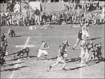 "Leon Hart runs for a touchdown in the 1948 tie with USC. ""It was the most destructive run I've ever seen,""  remarked Coach Leahy after the game."