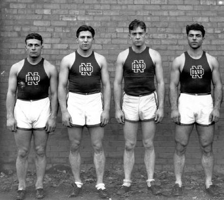 Carideo, O'Conner, Mullins and Savoldi in their track uniforms. (From the University of Notre Dame Archives)